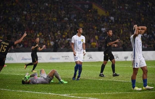 第29届东南亚运动会男足决赛:泰国队1-0击败马来西亚队夺得金牌 hinh anh 1