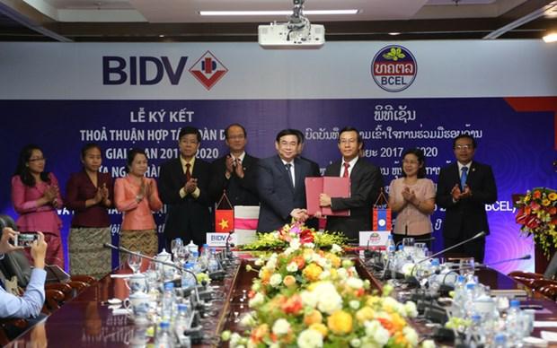 越南投资发展银行同老挝外贸银行签署全面合作协议 hinh anh 1