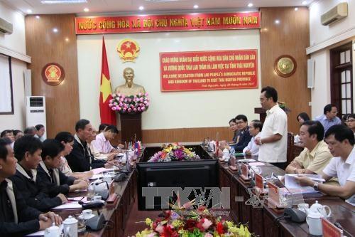 越老泰三国共同分享实施民族工作的经验 hinh anh 1