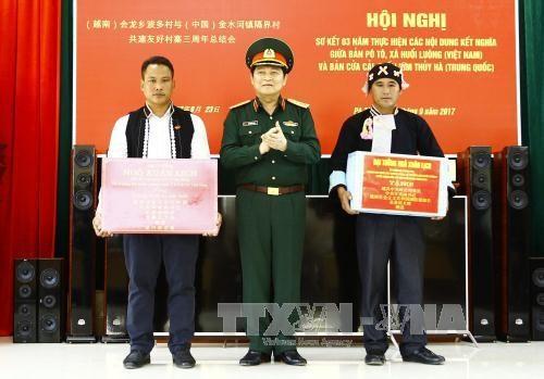 第4次越中边境国防友好交流活动:加强越中边境地区居民与军队的团结协作 hinh anh 2