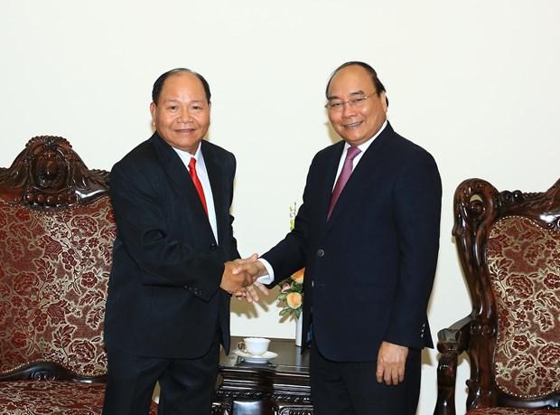 阮春福总理会见老挝内政部部长坎曼•舒魏勒 hinh anh 1