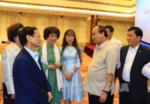 政府总理阮春福与国内一流私人经济集团领导进行政策对话 hinh anh 3