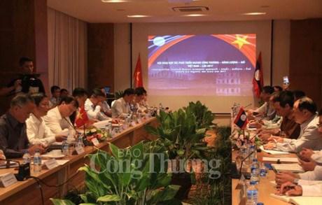 越老两国加强在工贸、能源和矿业等领域的合作 hinh anh 1