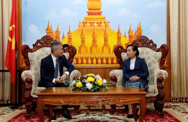 旅居老挝越侨捐款帮助老挝台风受灾灾民 hinh anh 1