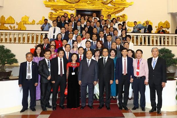 越南政府总理阮春福:企业将继续受政府推崇和保护 hinh anh 1