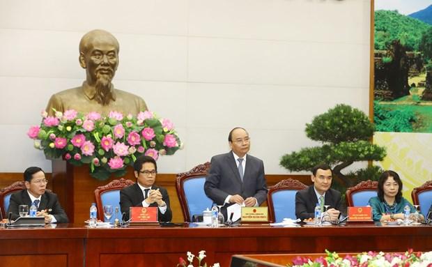 越南政府总理阮春福:企业将继续受政府推崇和保护 hinh anh 2