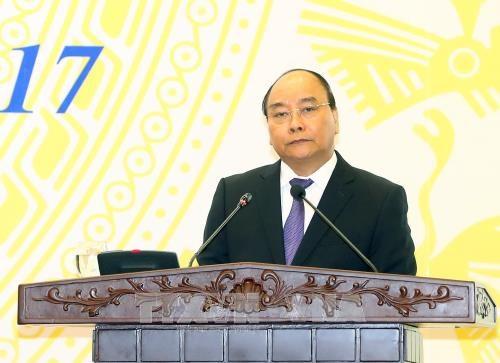 越南政府总理阮春福: 对政策性银行和贫困人口的投资就是为发展投资 hinh anh 1