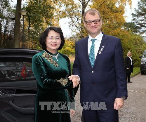 国家副主席邓氏玉盛访问芬兰 先后会见芬兰总理和议会议长 hinh anh 1