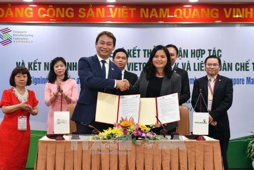 越南Vietcombank与新加坡制造商总会签署全面合作协议 hinh anh 1