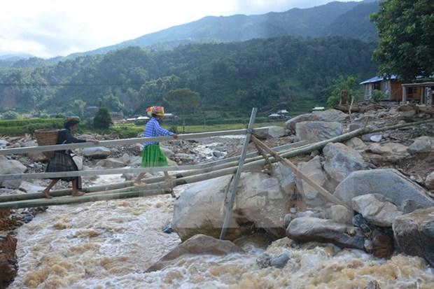 老挝国家主席和萨尔瓦多解放阵线总协调员致电慰问越南受灾群众 hinh anh 1