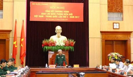 第四届越中边境国防友好交流活动总结会议在河内举行 hinh anh 1