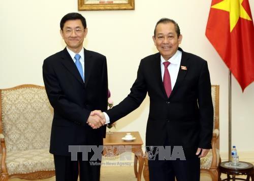 政府副总理张和平会见中国国家安全部副部长唐朝 hinh anh 1