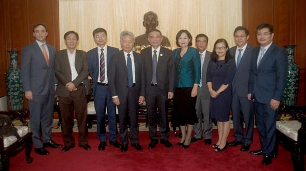 岘港市领导会见前来出席APEC会议的国际组织领导 hinh anh 1