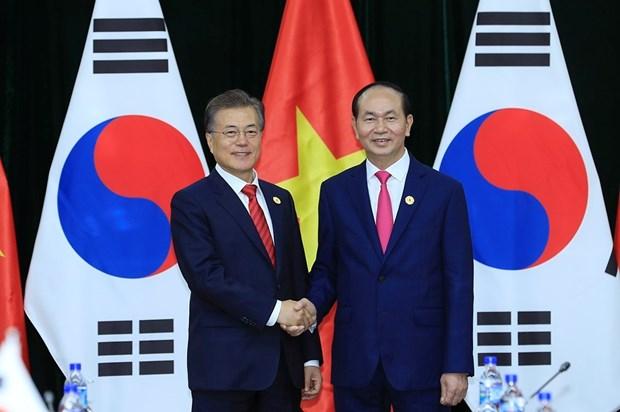 2017 年APEC会议: 越南国家主席陈大光会见柬埔寨首相和韩国总统 hinh anh 4