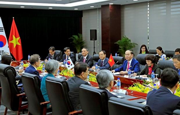 2017 年APEC会议: 越南国家主席陈大光会见柬埔寨首相和韩国总统 hinh anh 5
