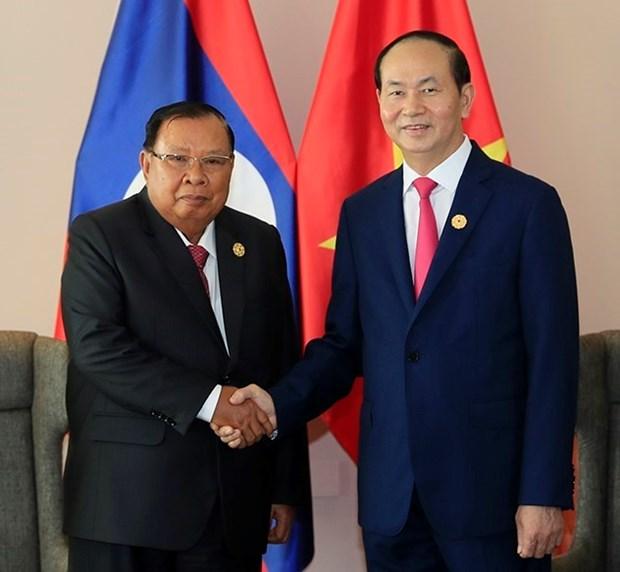 2017年APEC会议:国家主席陈大光会见老挝国家主席本扬•沃拉吉 hinh anh 1