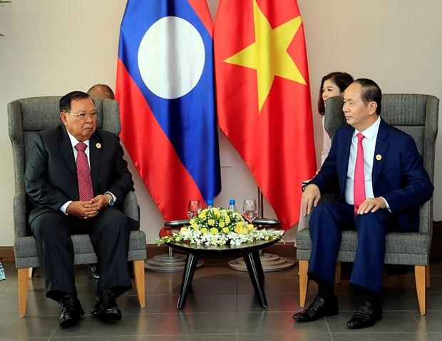 2017年APEC会议:国家主席陈大光会见老挝国家主席本扬•沃拉吉 hinh anh 2