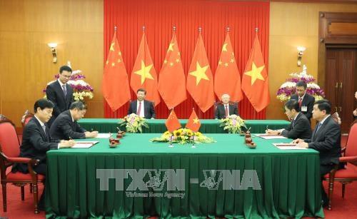 越南与中国签署和互相交换19项合作文件 hinh anh 1