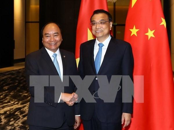 第31届东盟峰会: 越中一致同意推动双边贸易均衡发展 hinh anh 1