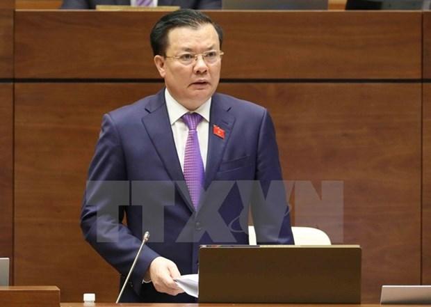 第十四届国会第四次会议:财政部长丁进勇接受国会代表质询 hinh anh 1