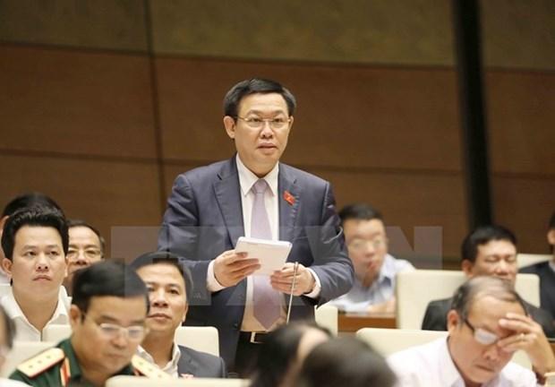 第十四届国会第四次会议:财政部长丁进勇接受国会代表质询 hinh anh 3
