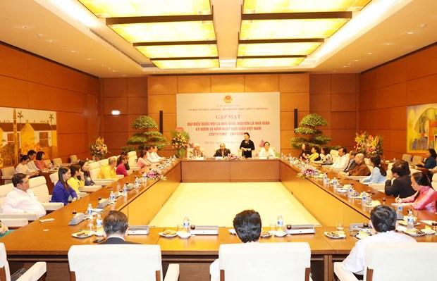 越南政府总理、国会主席会见教师、原教师国会代表 hinh anh 2