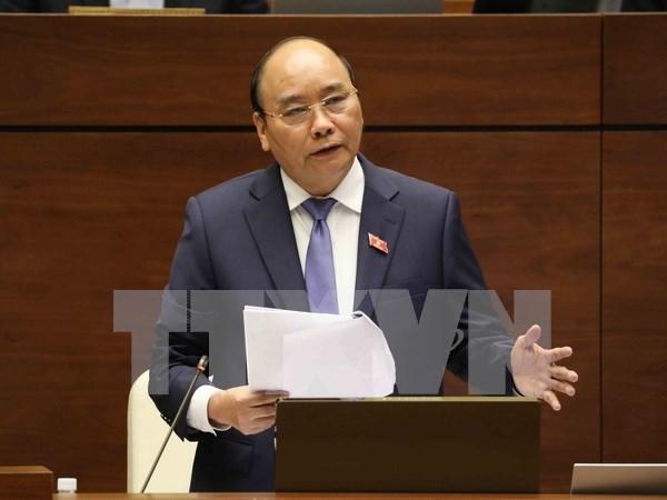 第十四届国会第四次会议:政府总理阮春福接受国会代表质询 hinh anh 1