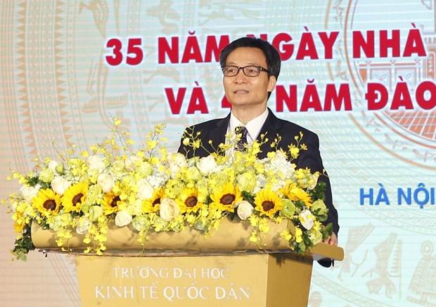 政府副总理武德儋出席国民经济大学的11.20越南教师节35周年纪念典礼 hinh anh 1