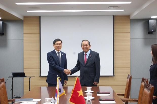 政府常务副总理访问韩国 深化两国司法合作 hinh anh 1