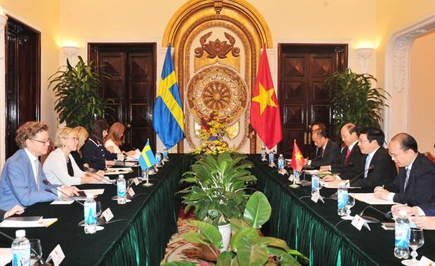 越南政府副总理兼外长范平明与瑞典外交部长玛戈特・瓦尔斯特伦举行会谈 hinh anh 2