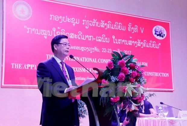 越南赴老出席第五次社会主义国际研讨会 hinh anh 2
