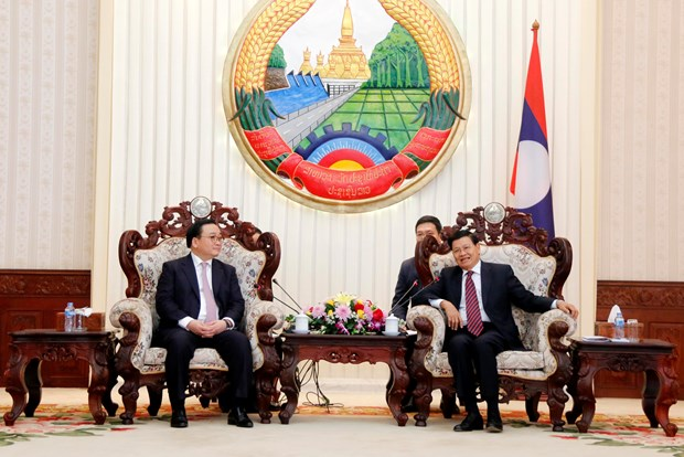 老挝领导会见河内市代表团 hinh anh 3