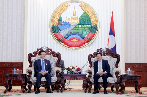 老挝总理通伦·西苏里会见越南司法部代表团 hinh anh 1