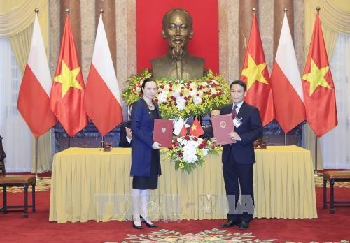 越南通讯社同波兰通讯社签署合作备忘录 hinh anh 1