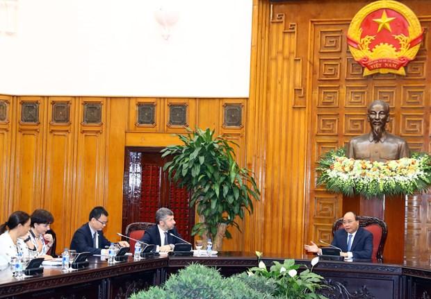 越南政府总理阮春福会见意大利经济发展部副部长 hinh anh 2