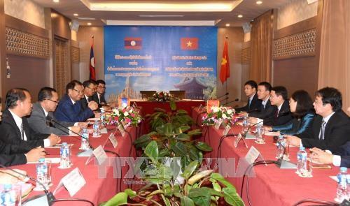老挝领导高度评价越南通讯社的支持与帮助 hinh anh 1