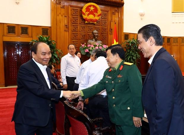 越南政府总理阮春福:安江省应推动经济建设和国防建设融合发展 hinh anh 1