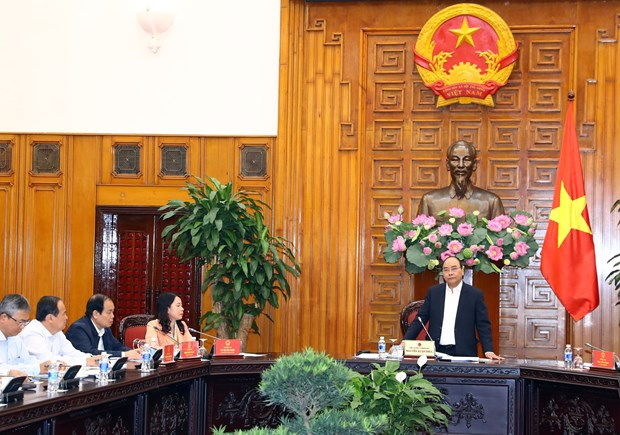 越南政府总理阮春福:安江省应推动经济建设和国防建设融合发展 hinh anh 2