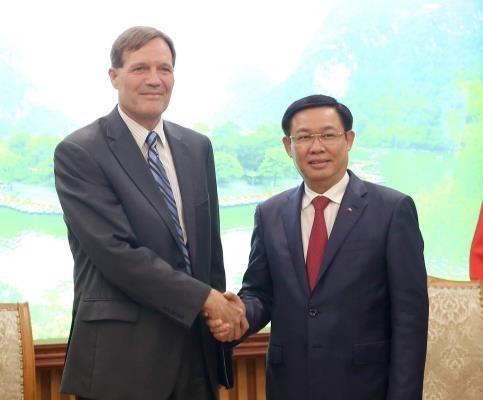 王廷惠副总理欢迎美国国际开发署为越南企业参加全球供应链提供协助 hinh anh 1