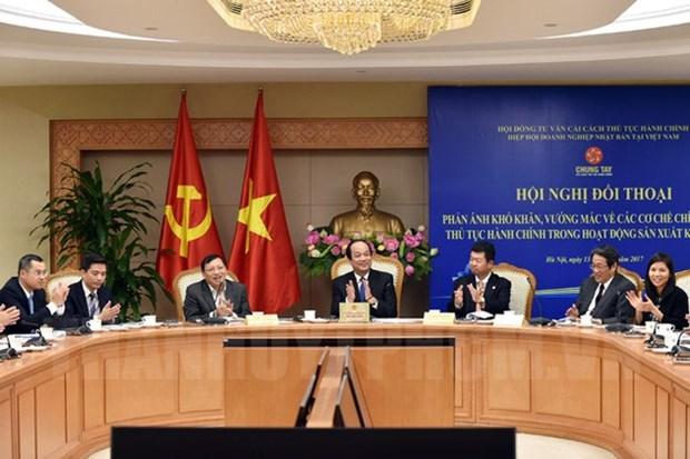 越南政府与日本企业对话 解决在机制政策方面的困难 hinh anh 1