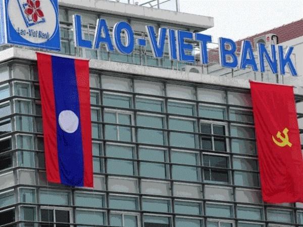 越老建交55周年:越南为老挝经济社会发展作出积极贡献 hinh anh 1