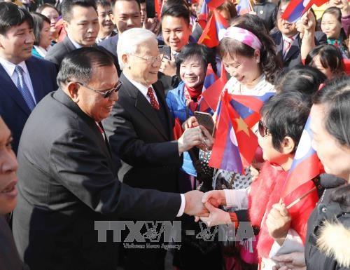 阮富仲举行仪式欢迎老挝人革党中央总书记、国家主席访越 hinh anh 2
