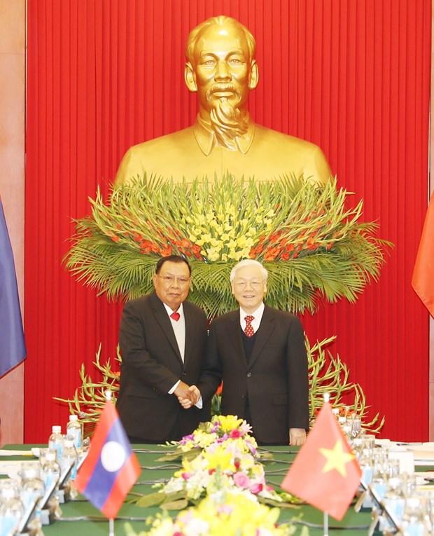 越共中央总书记阮富仲与老挝人民革命党中央委员会总书记、国家主席本扬举行会谈 hinh anh 2