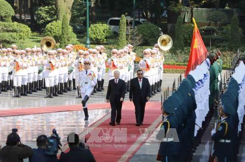 阮富仲举行仪式欢迎老挝人革党中央总书记、国家主席访越 hinh anh 1