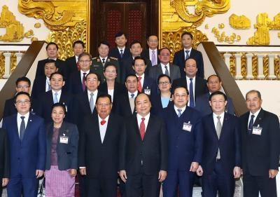 政府总理阮春福会见老挝人民革命党中央总书记本扬•沃拉吉 hinh anh 1