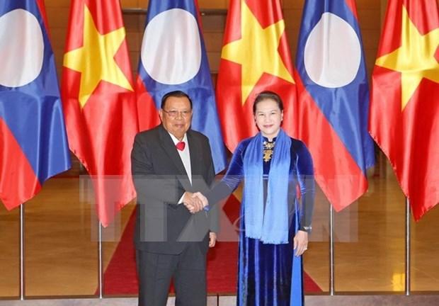 国会主席阮氏金银会见老挝人民革命党中央委员会总书记、国家主席本扬 hinh anh 1