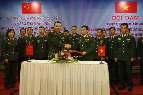 越南老街省边防与中国云南公安边防设立外事联络员及开通热线电话 hinh anh 2