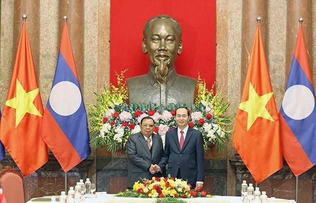 越南国家主席陈大光会见老挝人民革命党中央总书记、国家主席本扬·沃拉吉 hinh anh 1