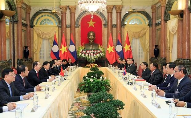 越南国家主席陈大光会见老挝人民革命党中央总书记、国家主席本扬·沃拉吉 hinh anh 2