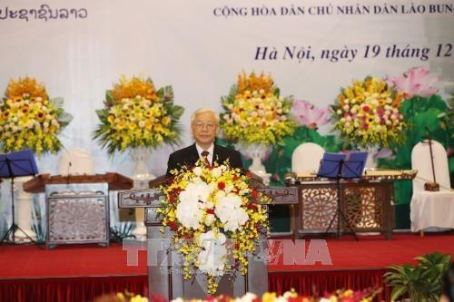越南领导设宴欢迎老挝人革党中央总书记、国家主席本扬·沃拉吉 hinh anh 1